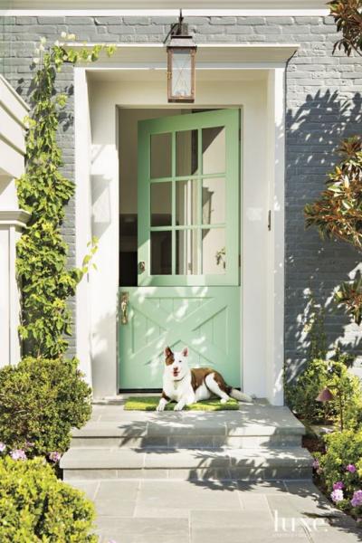 close up of entryway with seafoam green dutch door