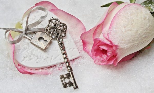 silver key with pink rose and lock