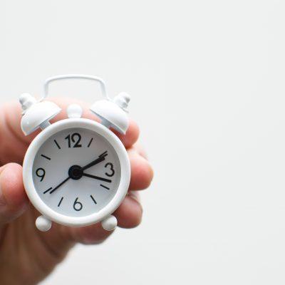 white miniature alarm clock