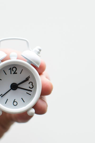 white miniature alarm clock