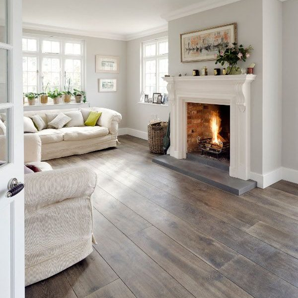 grey and white living room with greyish wood plank floors