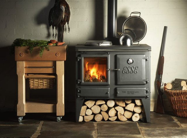 black esse wood cook stove with logs under it