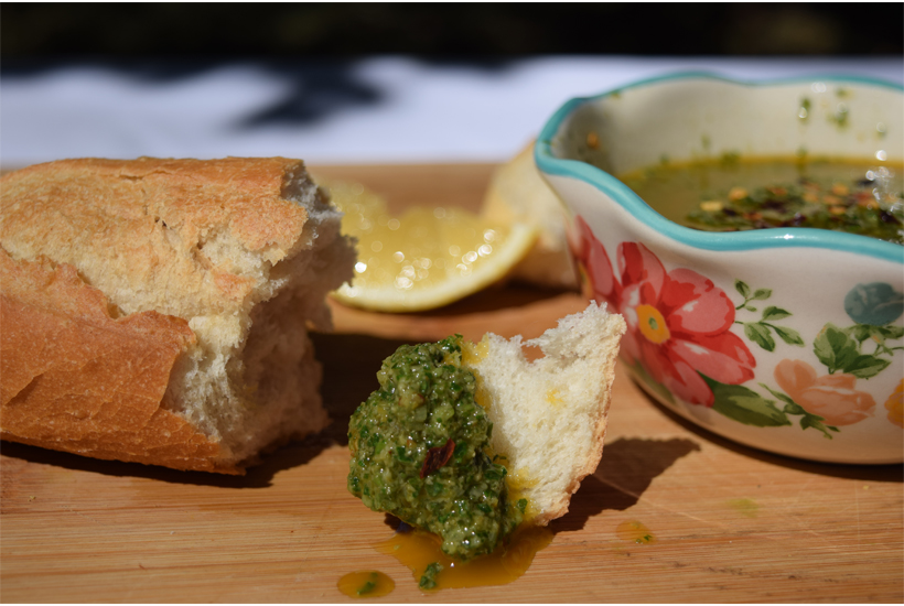 bread dipped into parsley salsa