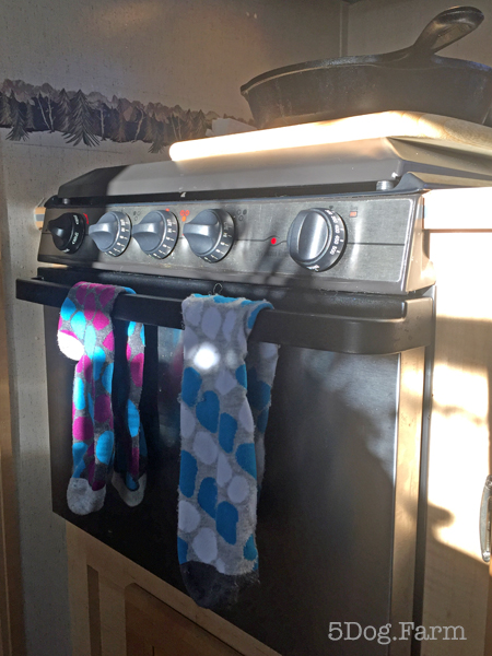 oven with socks hanging from handle