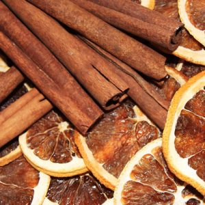cinnamon sticks and orange