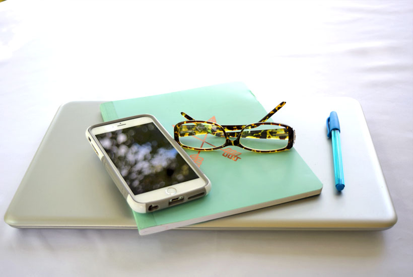 computer llight blue journal and leopard glasses