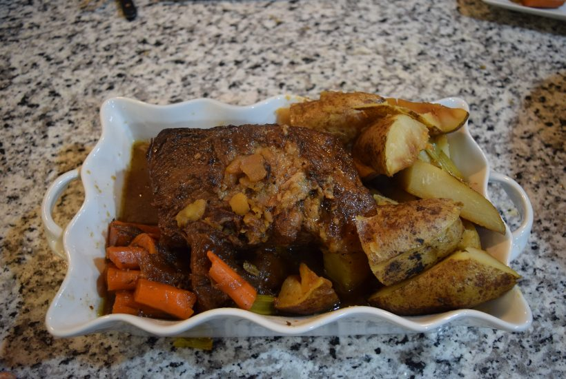 pot roast in white serving bowl
