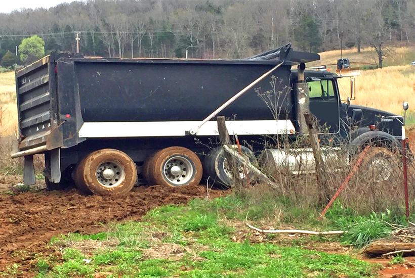 gravel truck stuck in the mud 5 dog farm