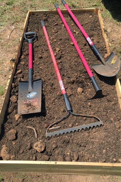 red garden tools in planter 5 dog famr