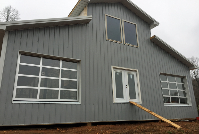 grey and white barn 5 dog farm