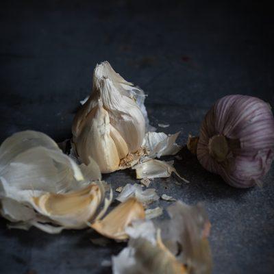 heads of garlic on slate