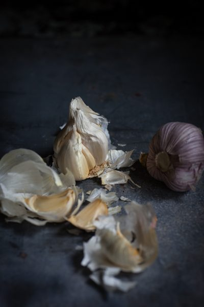 heads of garlic on slate