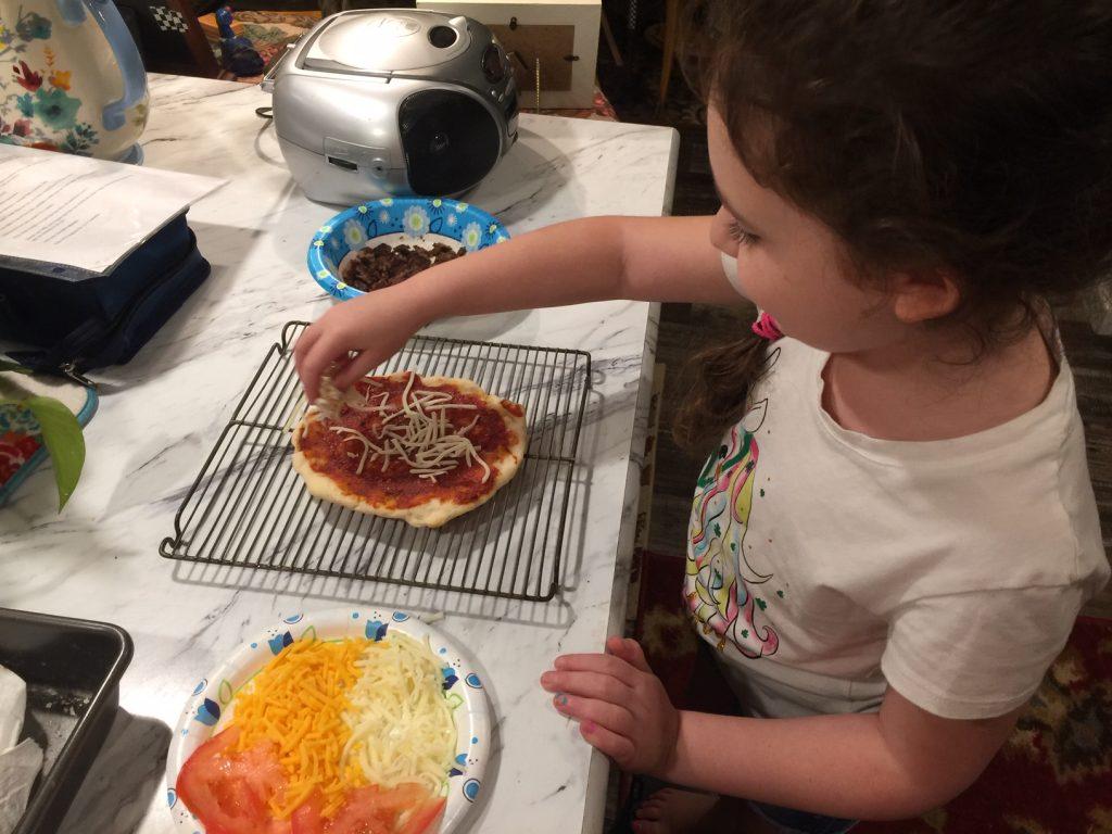 Maddi making her own pizza 5DogFarm